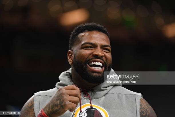 Washington Redskins offensive tackle Trent Williams smiles before the game between the Washington Redskins and the New Orleans Saints at the...