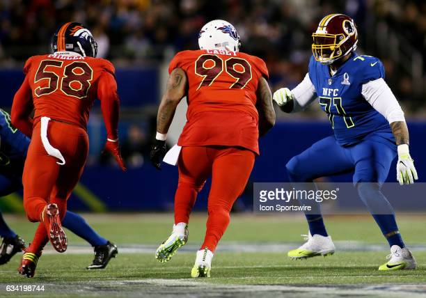 Washington Redskins offensive tackle Trent Williams takes on a double team from Denver Broncos linebacker Von Miller and Tennessee Titans defensive...