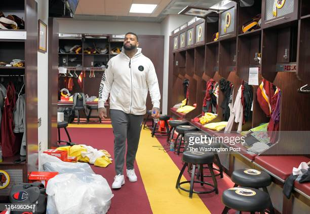 Washington Redskins offensive tackle Trent Williams walks through the locker room as the Redskins clean out lockers after last game of season at...