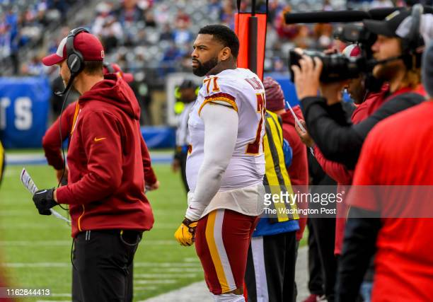 Washington Redskins offensive tackle Trent Williams watches from the sidelines in the fourth quarter against the New York Giants at MetLife Stadium