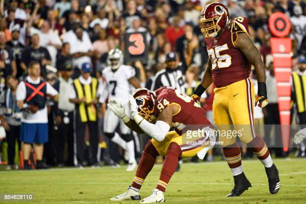 Washington Redskins outside linebacker Preston Smith celebrates a sack with defensive end Jonathan Allen against the Oakland Raiders on September 24...
