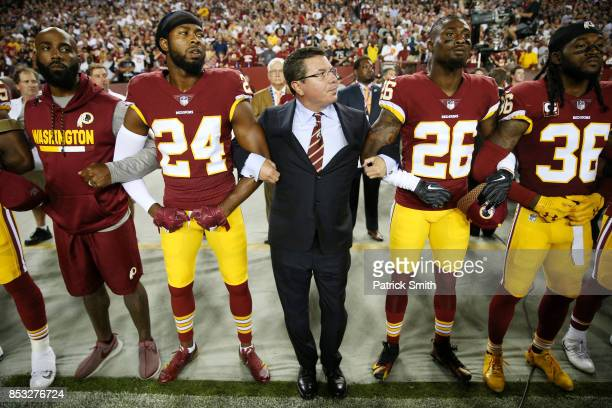 Washington Redskins Owner Daniel Synder stands with cornerback Josh Norman and cornerback Bashaud Breeland during the the national anthem before the...