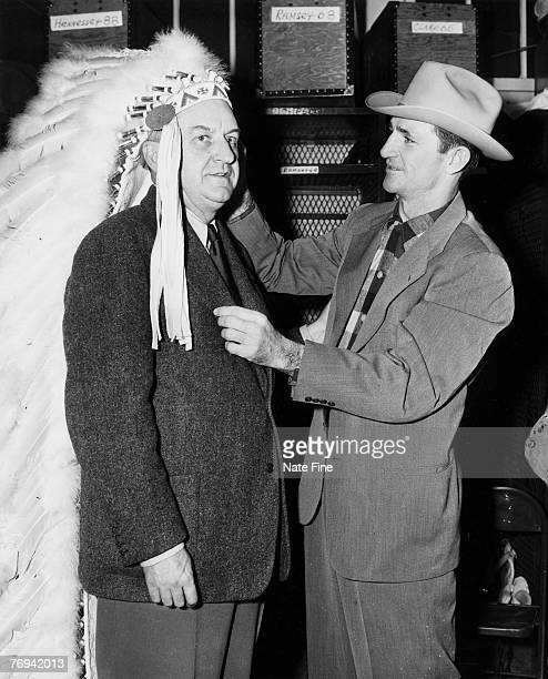 Washington Redskins owner George Preston Marshall and Hall of Fame quarterback Sammy Baugh in the lockerrom circa 1940's