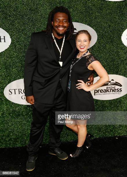 Washington Redskins player DJ Swearinger and a guest arrive at The Stronach Group Owner's Chalet at 142nd Preakness Stakes at Pimlico Race Course on...