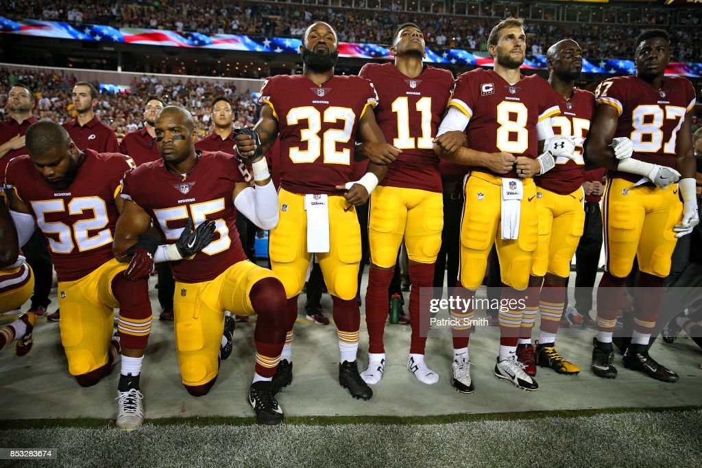 Washington Redskins players during the the national anthem before the game against the Oakland Raiders at FedExField on September 24, 2017 in Landover, Maryland.