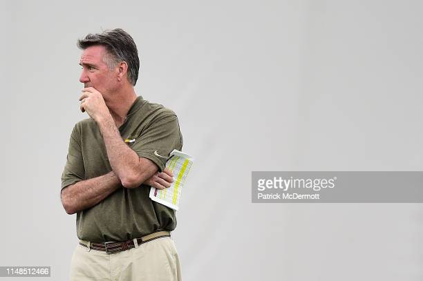 Washington Redskins president Bruce Allen stands on the field during Washington Redskins rookie camp on May 11 2019 in Ashburn Virginia