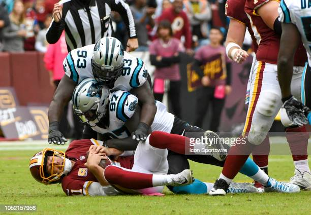 Washington Redskins quarterback Alex Smith is sacked by Carolina Panthers defensive end Mario Addison and defensive tackle Kyle Love on October 14 at...