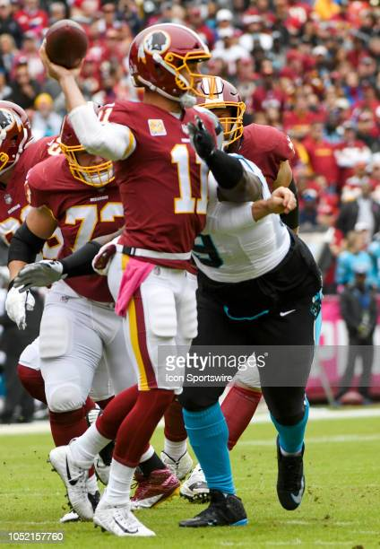 Washington Redskins quarterback Alex Smith passes under pressure from Carolina Panthers defensive tackle Kawann Short on October 14 at FedEx Field in...