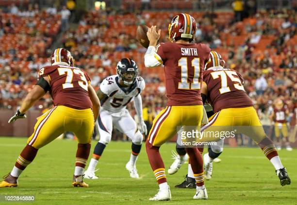 Washington Redskins quarterback Alex Smith takes a first quarter snap in action against the Denver Broncos on August 24 at FedEx Field in Landover MD