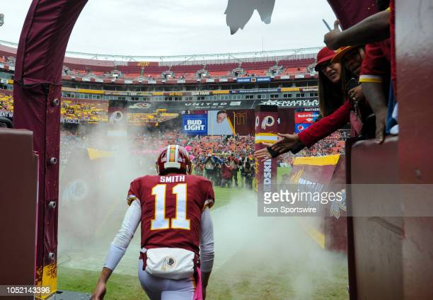 Washington Redskins quarterback Alex Smith takes the field for the game against the Carolina Panthers on October 14 at FedEx Field in Landover MD The...