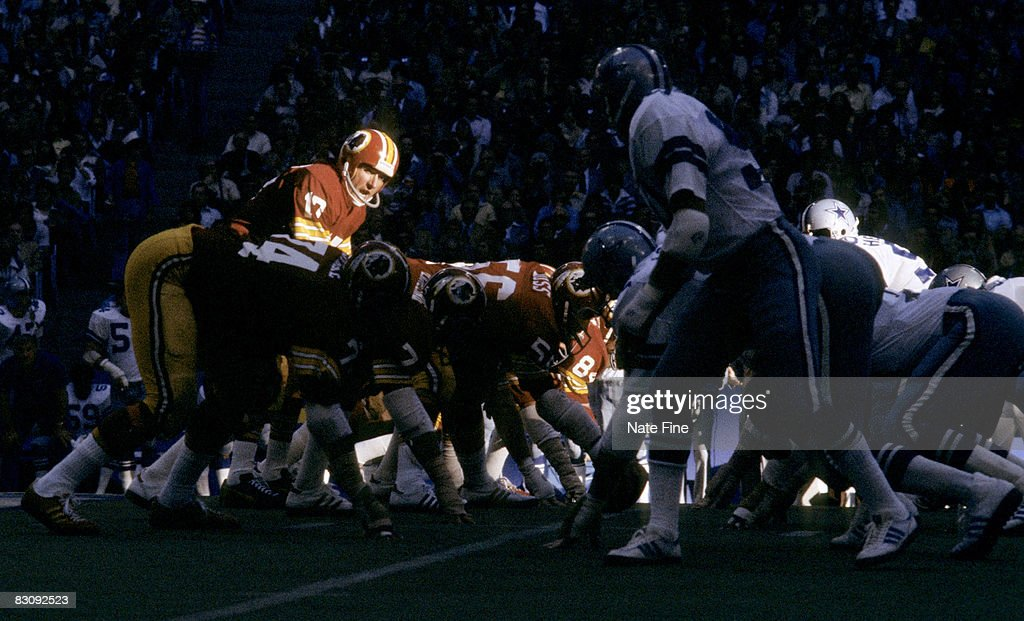 Washington Redskins quarterback Billy Kilmer calls signals and waits for the snap in a 34-16 loss to the the Dallas Cowboys on October 16, 1977 at Texas Stadium in Irving, Texas.