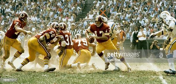 Washington Redskins quarterback Billy Kilmer escapes the pocket during 380 victory over the San Diego Chargers on September 16 at RFK Stadium in...