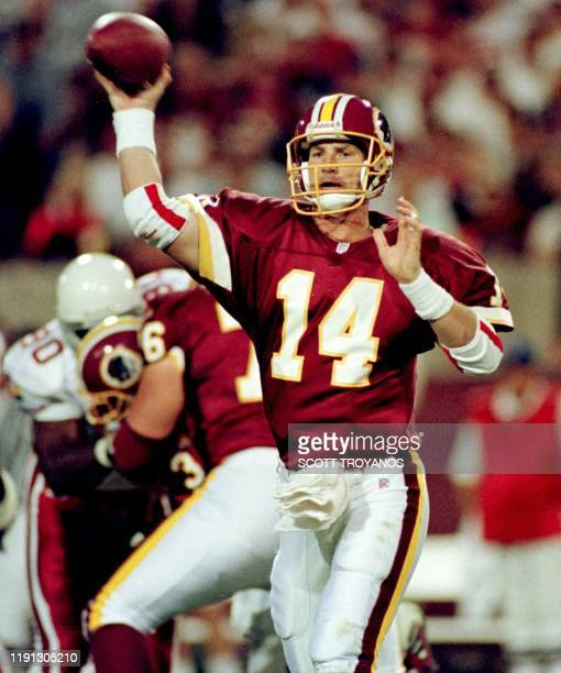 Washington Redskins quarterback Brad Johnson throws in the second quarter of their game with the Arizona Cardinals in Tempe Arizona 17 October 1999...