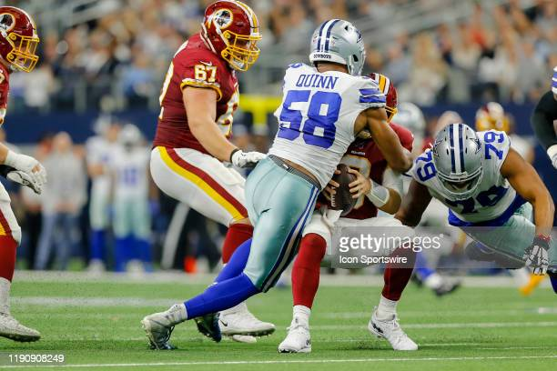 Washington Redskins quarterback Case Keenum gets sacked by Dallas Cowboys defensive end Robert Quinn during the game between the Dallas Cowboys and...