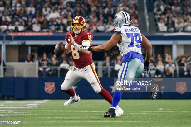 Washington Redskins Quarterback Case Keenum is chased by Dallas Cowboys Defensive End Michael Bennett during the NFC East game between the Dallas...