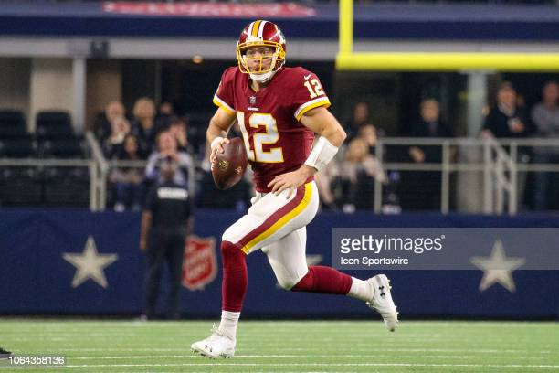 Washington Redskins Quarterback Colt McCoy runs a bootleg during the Thanksgiving Day game between the Washington Redskins and Dallas Cowboys on...