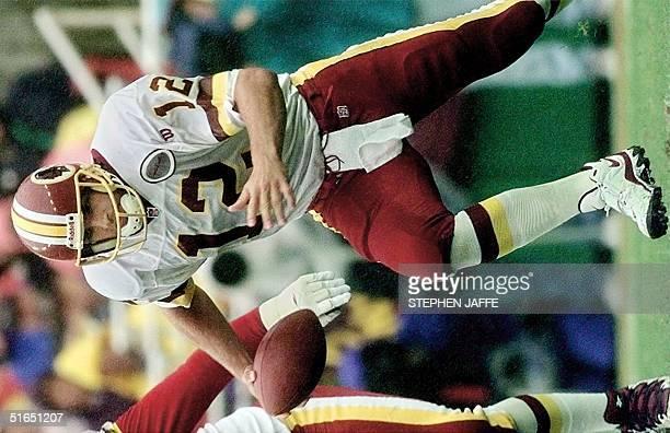 Washington Redskins quarterback Gus Frerotte evades the Jacksonville Jaguars defense during the first half of action 28 September at Jack Kent Cooke...