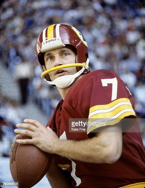 Washington Redskins quarterback Joe Theismann warms up before the Redskins 3710 loss to the Dallas Cowboys on November 23 1978 at Texas Stadium in...