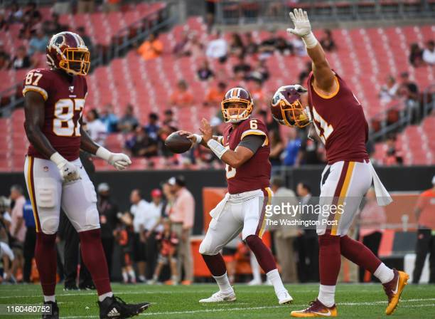 Washington Redskins quarterback Josh Woodrum warms up before the first preseason game between the Washington Redskins and the Cleveland Browns at...