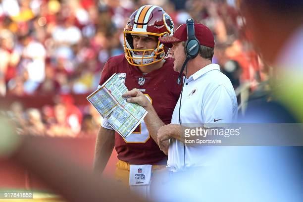 Washington Redskins quarterback Kirk Cousins talks with Washington Redskins head coach Jay Gruden during a NFL football game between the San...