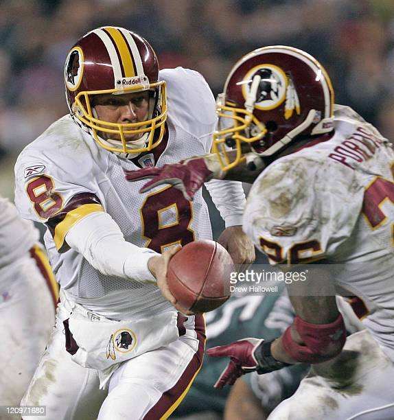 Washington Redskins quarterback Mark Brunell hands the ball off to running back Clinton Portis Sunday January 1 2006 at Lincoln Financial Filed in...