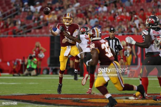 Washington Redskins quarterback Nate Sudfeld delivers a pass to Washington Redskins running back Samaje Perine over Tampa Bay Buccaneers defensive...