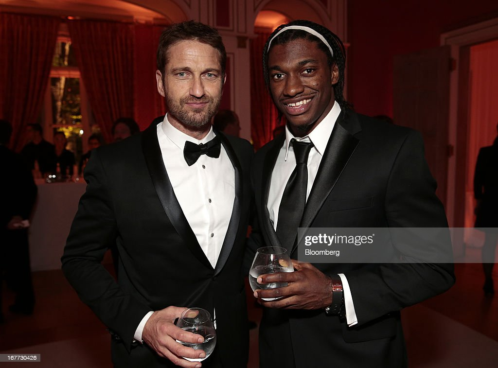 Washington Redskins quarterback Robert Griffin III, right, and actor Gerard Butler attend the Bloomberg Vanity Fair White House Correspondents' Association (WHCA) dinner afterparty in Washington, D.C., U.S., on Saturday, April 27, 2013. The 99th annual dinner raises money for WHCA scholarships and honors the recipients of the organization's journalism awards. Photographer: Andrew Harrer/Bloomberg via Getty Images