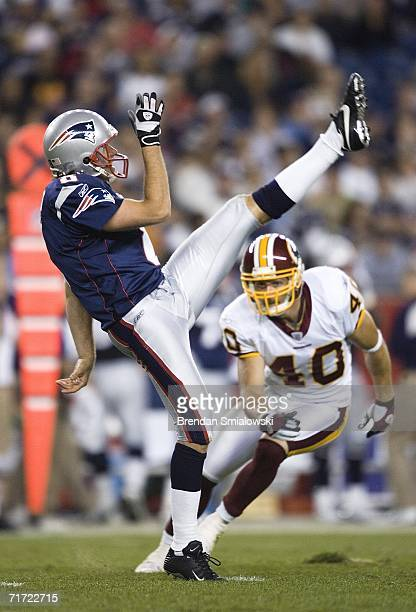 Washington Redskins Redskins Adam Archuleta runs to New England Patriots Josh Miller after a punt during the first half of a preseason game at...