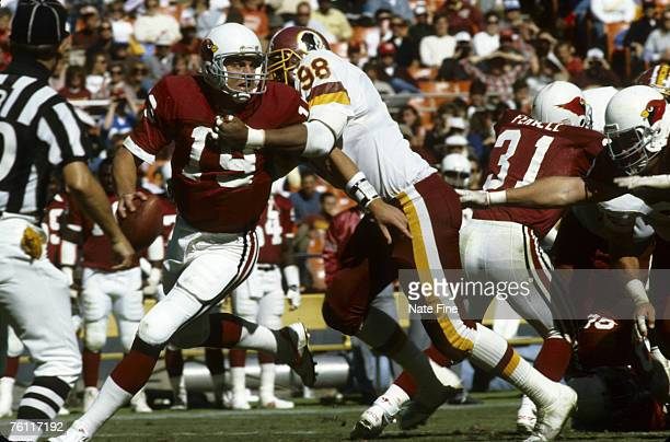 Washington Redskins replacement defensive end Steve Martin has a grip on Cardinals replacement quarterback Shawn Halloran during the Redskins 2821...