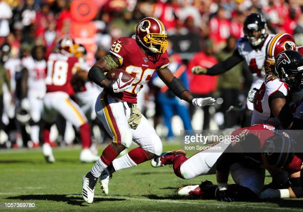 Washington Redskins running back Adrian Peterson attempts to rush upfield during the game between the Atlanta Falcons and the Washington Redskins on...