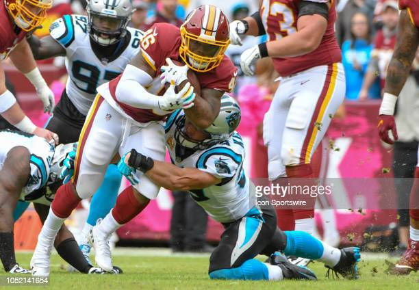Washington Redskins running back Adrian Peterson breaks off a long run in the second quarter against Carolina Panthers linebacker Luke Kuechly on...