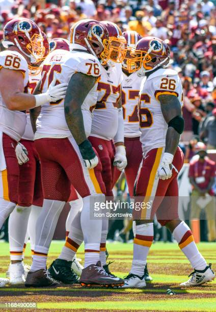 Washington Redskins running back Adrian Peterson celebrates with center Tony Bergstrom , offensive tackle Morgan Moses , and offensive tackle Ereck...