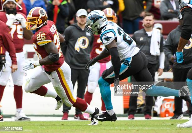 Washington Redskins running back Adrian Peterson is pursued by Carolina Panthers free safety Mike Adams after a long run on October 14 at FedEx Field...