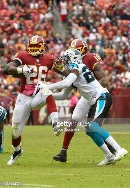 Washington Redskins running back Adrian Peterson runs for a first down in the fourth quarter against Carolina Panthers cornerback James Bradberry on...