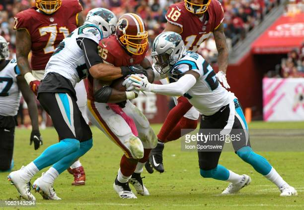Washington Redskins running back Adrian Peterson runs for a first down in the fourth quarter against Carolina Panthers cornerback James Bradberry and...