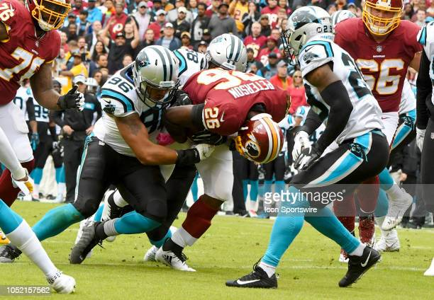 Washington Redskins running back Adrian Peterson runs for a first down against Carolina Panthers defensive end Wes Horton on October 14 at FedEx...