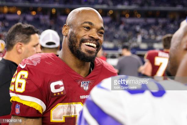 Washington Redskins Running Back Adrian Peterson talks with players after the NFC East game between the Dallas Cowboys and Washington Redskins on...