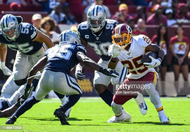 Washington Redskins running back Chris Thompson runs the ball against Dallas Cowboys free safety Xavier Woods in action on September 15 at FedEx...
