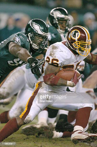 Washington Redskins running back Clinton Portis is pursued by Philadelphia Eagles defensive end ND Kalu on Sunday January 1 2006 at Lincoln Financial...