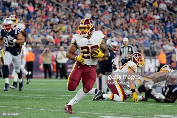 Washington Redskins running back Derrius Guice carries the ball during a preseason NFL game between the New England Patriots and the Washington...