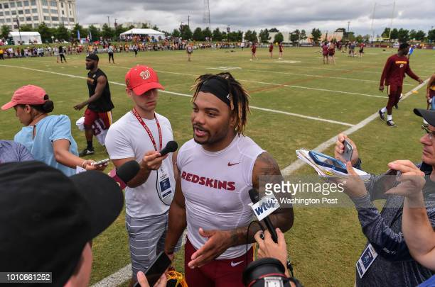 Washington Redskins running back Derrius Guice talks to reporters following morning practice at Redskins training camp on July 31, 2018 in Richmond,...