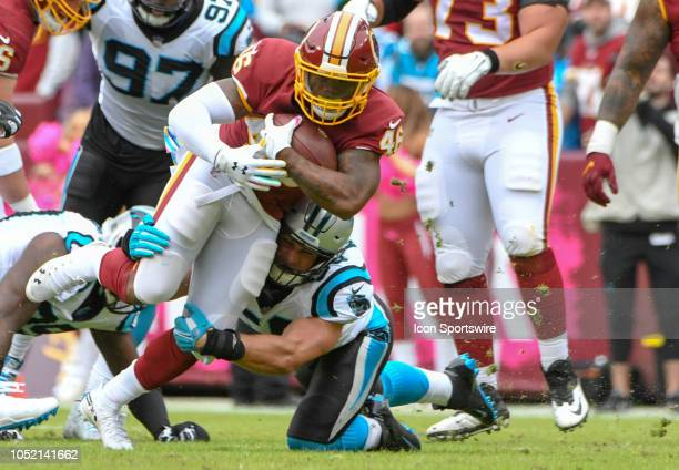 Washington Redskins running back Kapri Bibbs is brought down after a gain by Carolina Panthers linebacker Luke Kuechly on October 14 at FedEx Field...