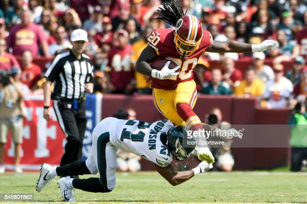 Washington Redskins running back Rob Kelley is brought down by Philadelphia Eagles defensive back Patrick Robinson on September 10 at FedEx Field in...