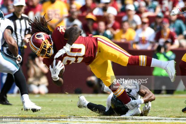 Washington Redskins running back Rob Kelley is tripped up by Philadelphia Eagles defensive back Patrick Robinson in the second quarter on September...