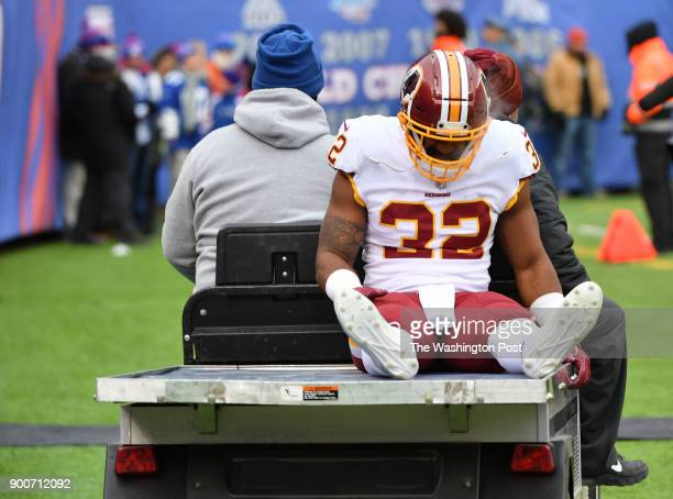 Washington Redskins running back Samaje Perine is carted off the field following an injury during the first quarter in a game against the Washington...