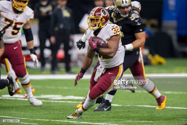 Washington Redskins running back Samaje Perine runs away from New Orleans Saints defensive tackle Tyeler Davison on November 19 2017 at the...