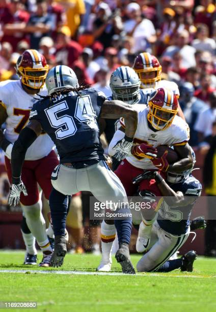 Washington Redskins running back Wendell Smallwood in action against Dallas Cowboys free safety Xavier Woods on September 15 at FedEx Field in...