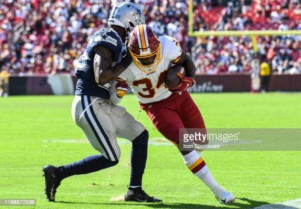 Washington Redskins running back Wendell Smallwood is forced out of bounds by Dallas Cowboys free safety Xavier Woods on September 15 at FedEx Field...