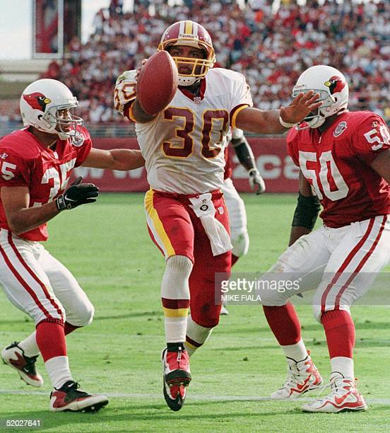 Washington Redskins' runningback Brian Mitchell scores his team's second touchdown between Arizona Cardinals' safety Aeneas Williams and linebacker...