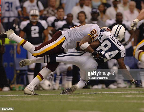 Washington Redskins safety Sean Taylor tackles Dallas Cowboys wide receiver Patrick Clayton during a Monday Night Football game September 19 2005 in...